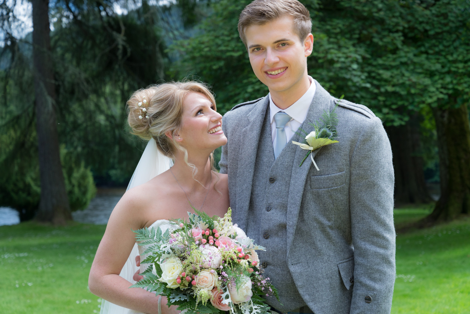 Bride and groom - romantic by the river Tay at Dunkeld House Hotel 8