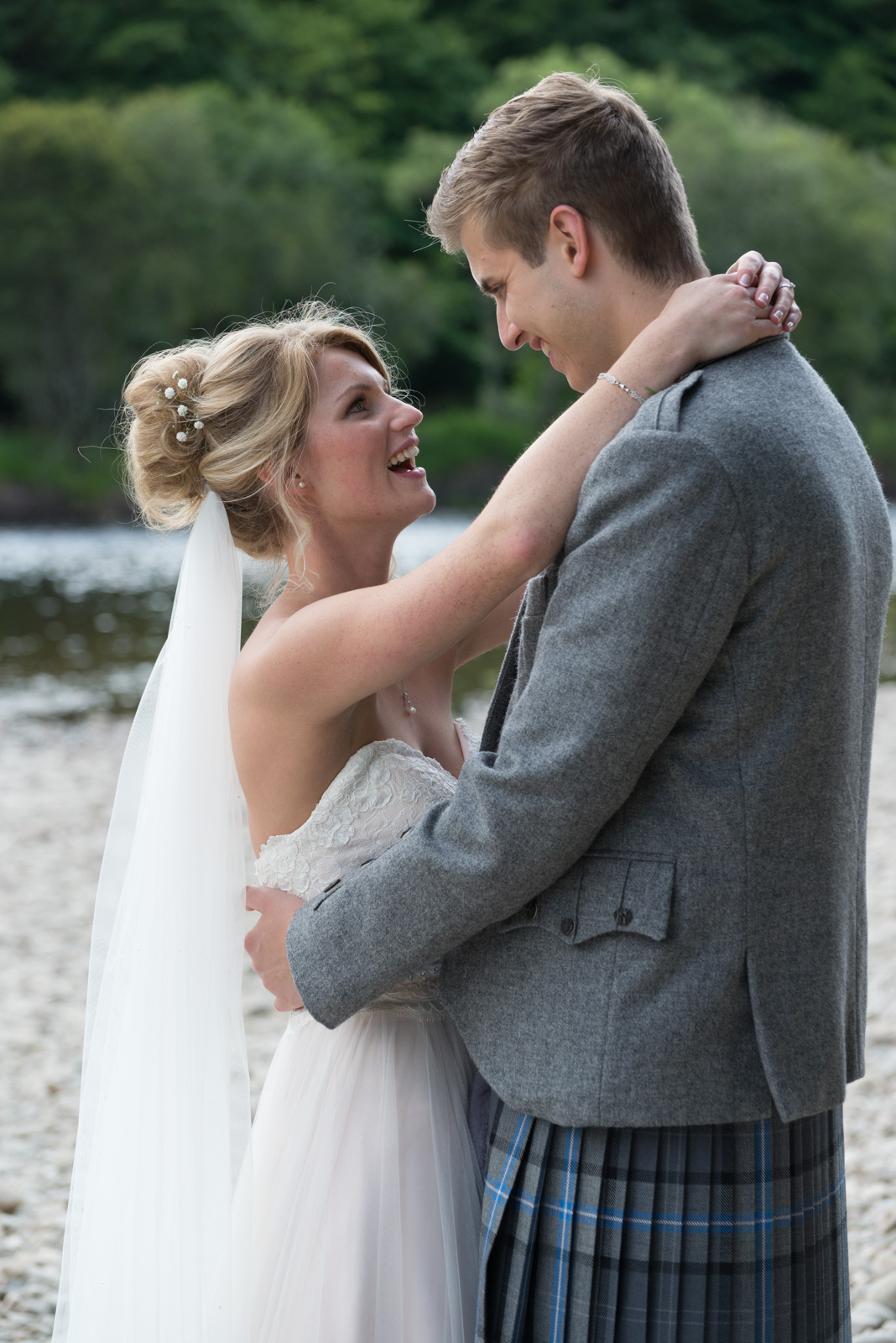 Bride and groom - romantic by the river Tay at Dunkeld House Hotel 7