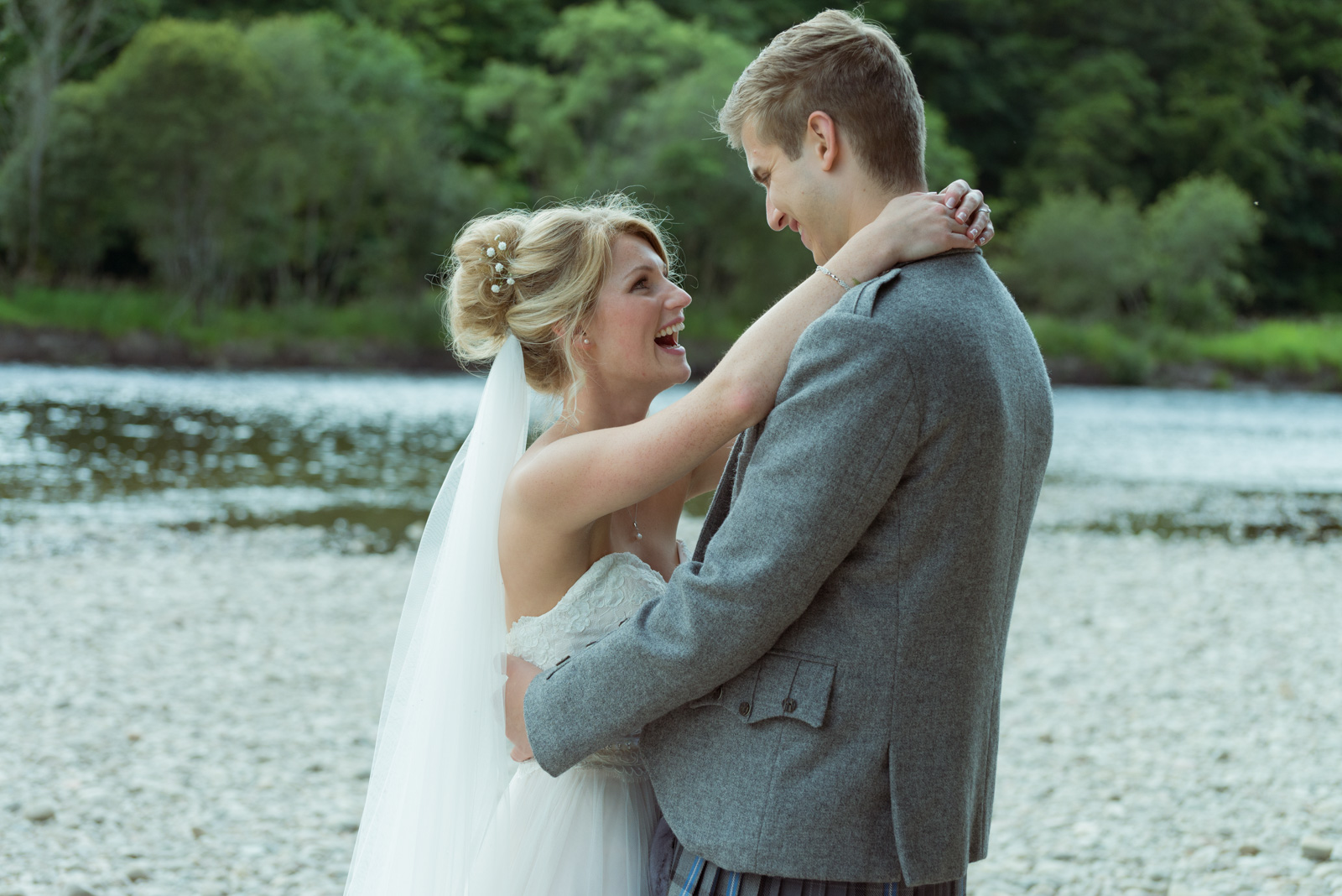 Bride and groom - romantic by the river Tay at Dunkeld House Hotel 1