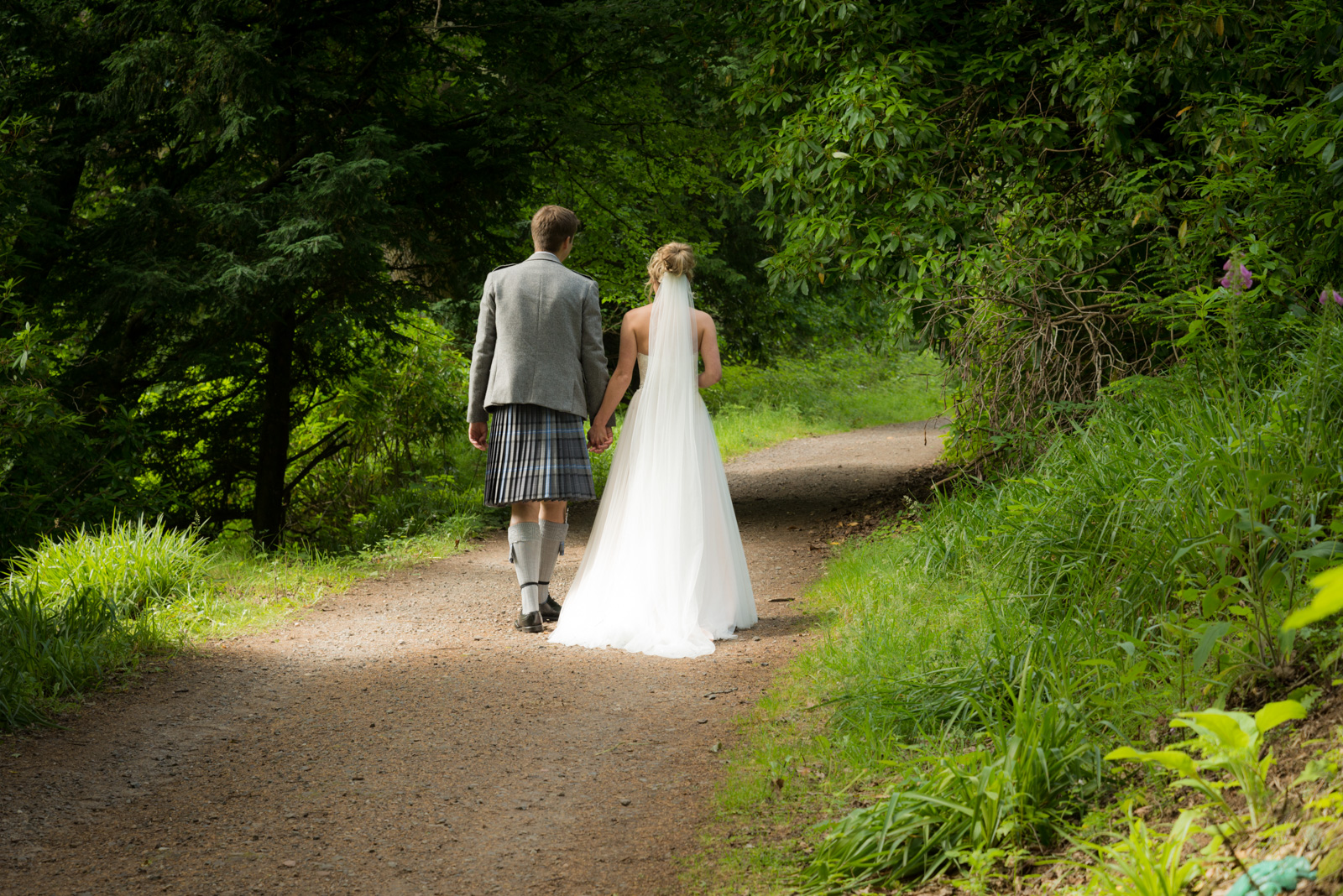 Bride and groom - romantic by the river Tay at Dunkeld House Hotel 2