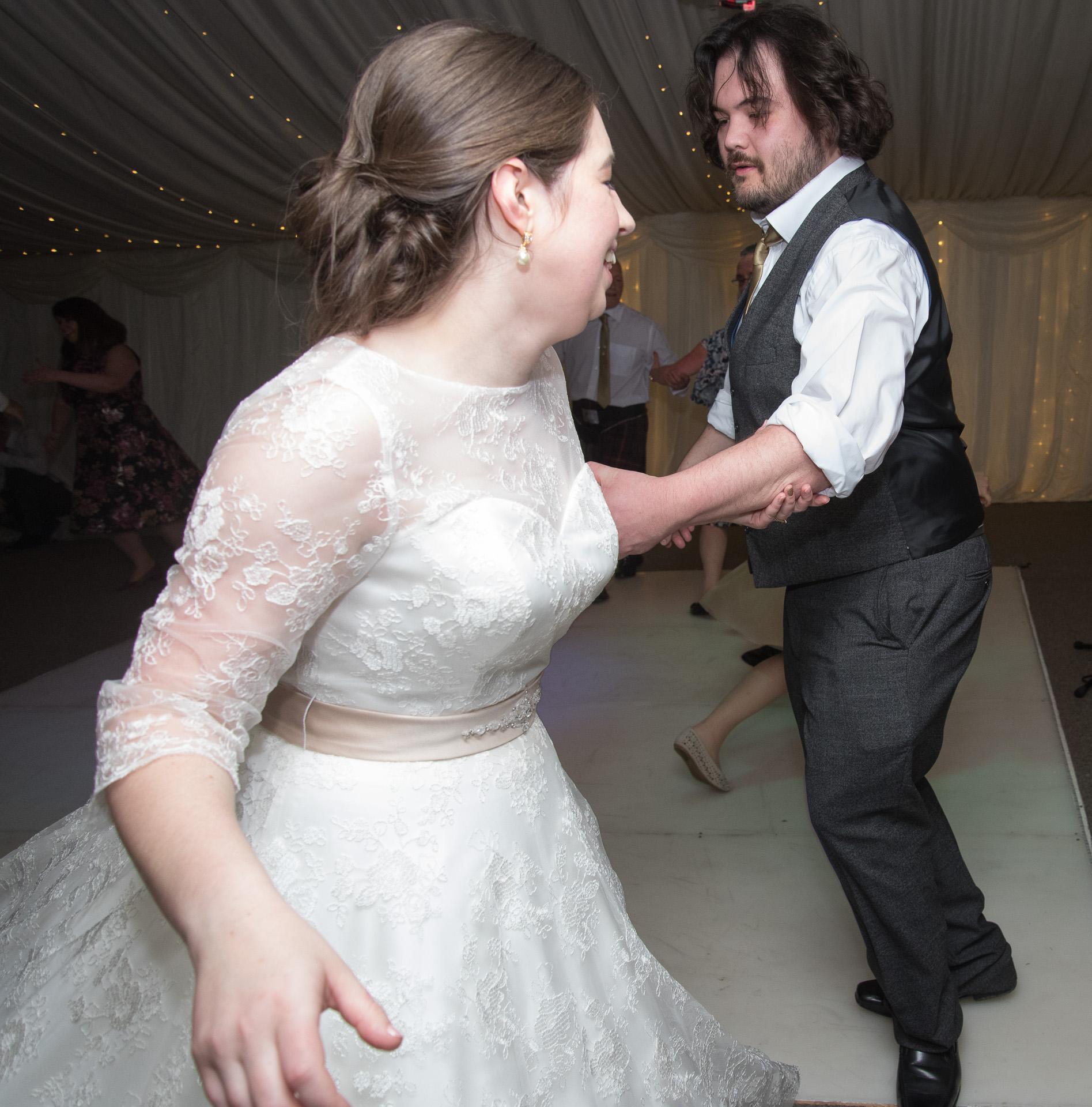 wedding couple dancing at reception