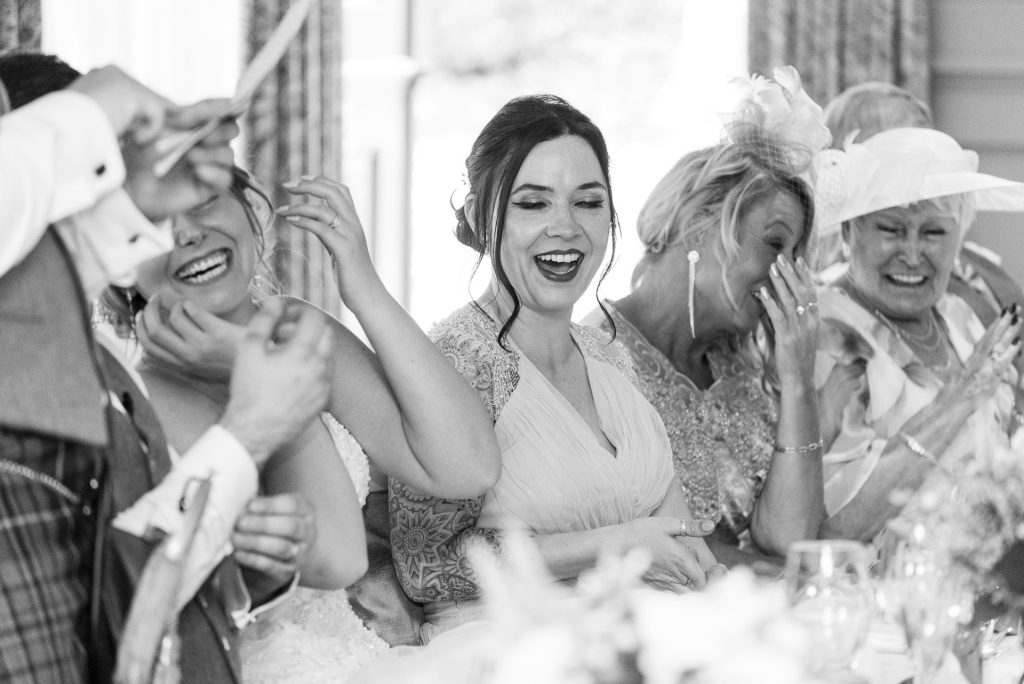 Ladies laughing at the wedding top table