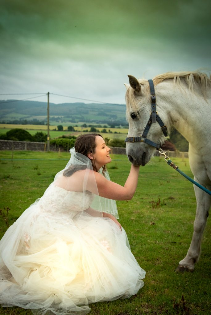 Bride with horse on a farm